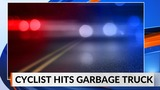 Bicyclist hits garbage truck